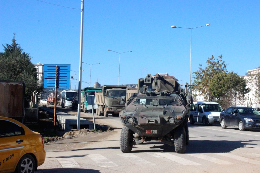 ANKARA, Dec. 24, 2018 (Xinhua) -- Photo taken on Dec. 24, 2018 shows a batch of military vehicles deployed in Kilis province, Turkey. Turkey has sent military reinforcements to its border with Syria, state-run media reported on Monday, after Ankara a