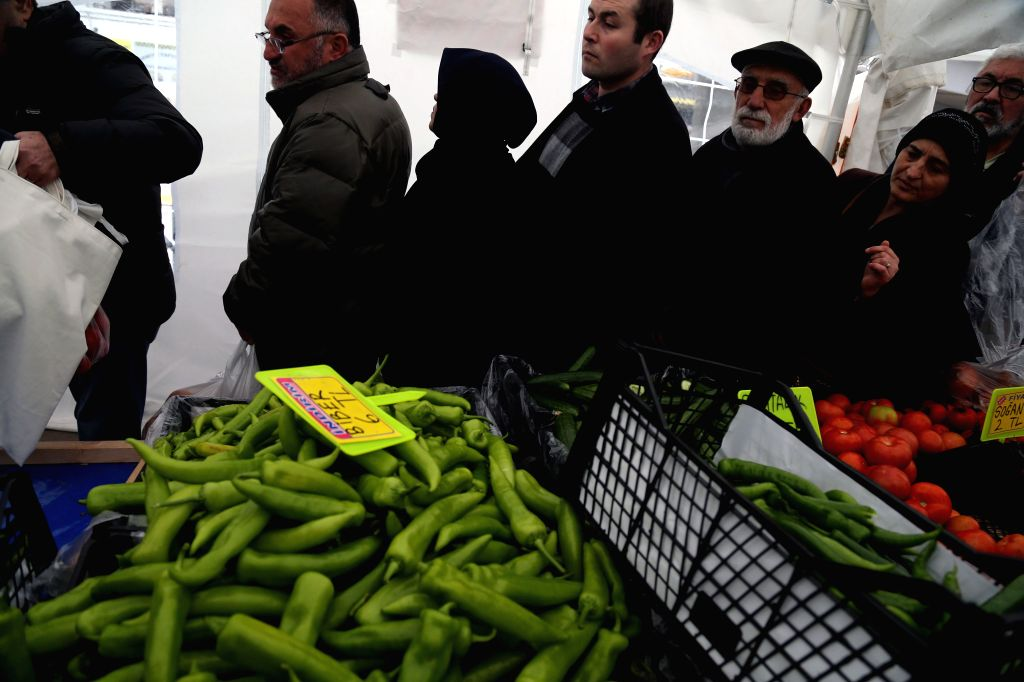 ANKARA, Feb. 14, 2019 - People queue up to buy cheap fruits and vegetables at a tent set by local municipality in Ankara, Turkey, on Feb. 13, 2019. On Monday, sales aiming to curb food prices have ...