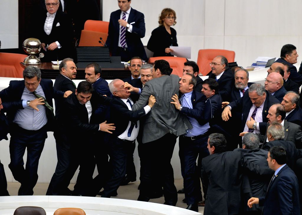 Photo taken on Feb. 19, 2015 shows the fight between parliamentarians during the first day of debates in Turkish legislature's General Assembly on a government-led ...