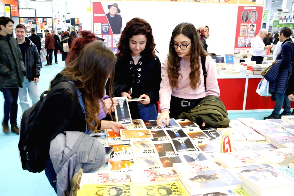 ANKARA, Feb. 20, 2019 - People select books on the 13th Ankara book fair in Ankara, Turkey, Feb. 18, 2019. The 13th Ankara book fair has attracted tens of thousands of book lovers since it opened ...