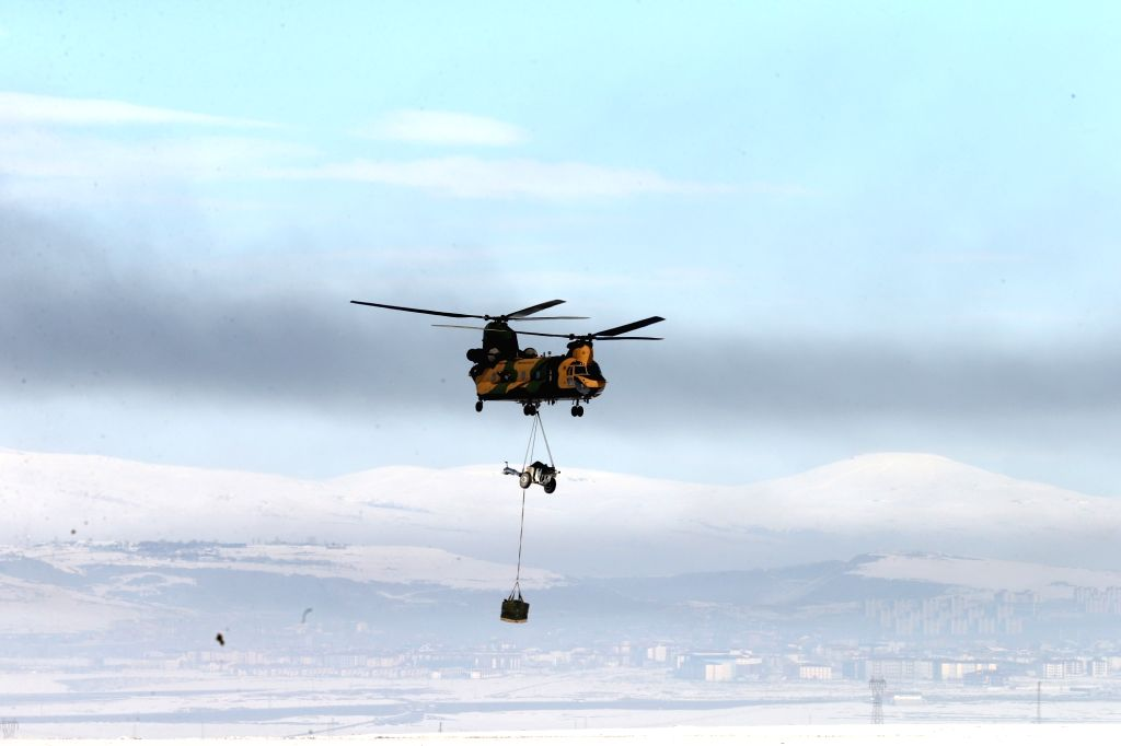 """ANKARA, Feb. 21, 2019 - A helicopter performs in an international military exercise codenamed """"Winter 2019"""" in Kars, Turkey, Feb. 21, 2019. Turkey is holding large-scale international ..."""