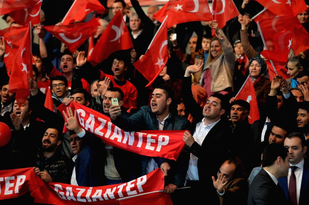 """ANKARA, Feb. 25, 2017 - Supporters wave banners and shout slogans during Turkish ruling Justice and Development Party (AKP)'s """"Yes"""" campaign for the April 16 constitutional referendum in ..."""