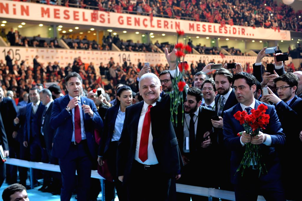 """ANKARA, Feb. 25, 2017 - Turkish Prime Minister Binali Yildirim (C) throws flowers to supporters during Turkish ruling Justice and Development Party (AKP)'s """"Yes"""" campaign for the April 16 ... - Binali Yildirim"""