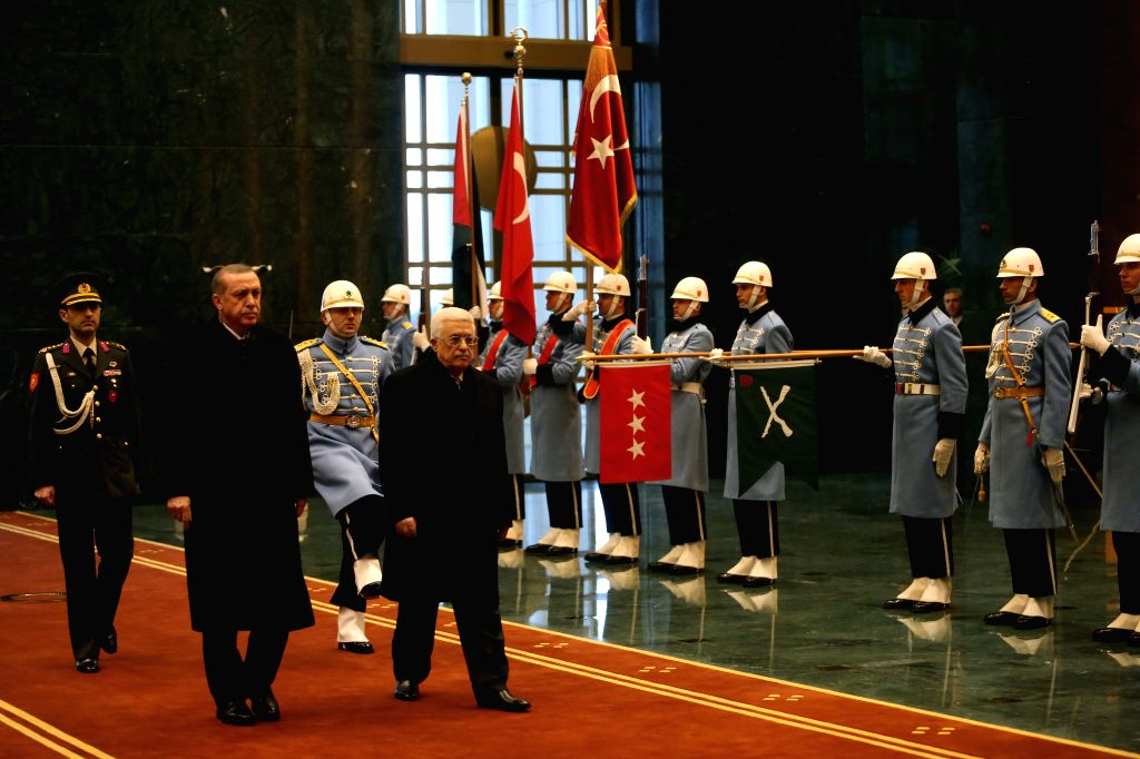 Turkish President Recep Tayyip Erdogan (L) holds a welcome ceremony for the visiting Palestinian President Mahmoud Abbas (2nd L) in the new presidential palace in ...