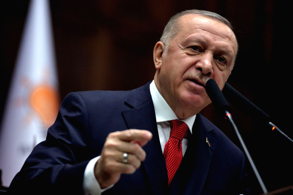 "ANKARA, Jan. 14, 2020 (Xinhua) -- Turkish President Recep Tayyip Erdogan speaks to his party members at the parliament in Ankara, Turkey, on Jan. 14, 2020. Recep Tayyip Erdogan warned on Tuesday that Turkey would ""teach a lesson"" to Khalifa Haftar, c"