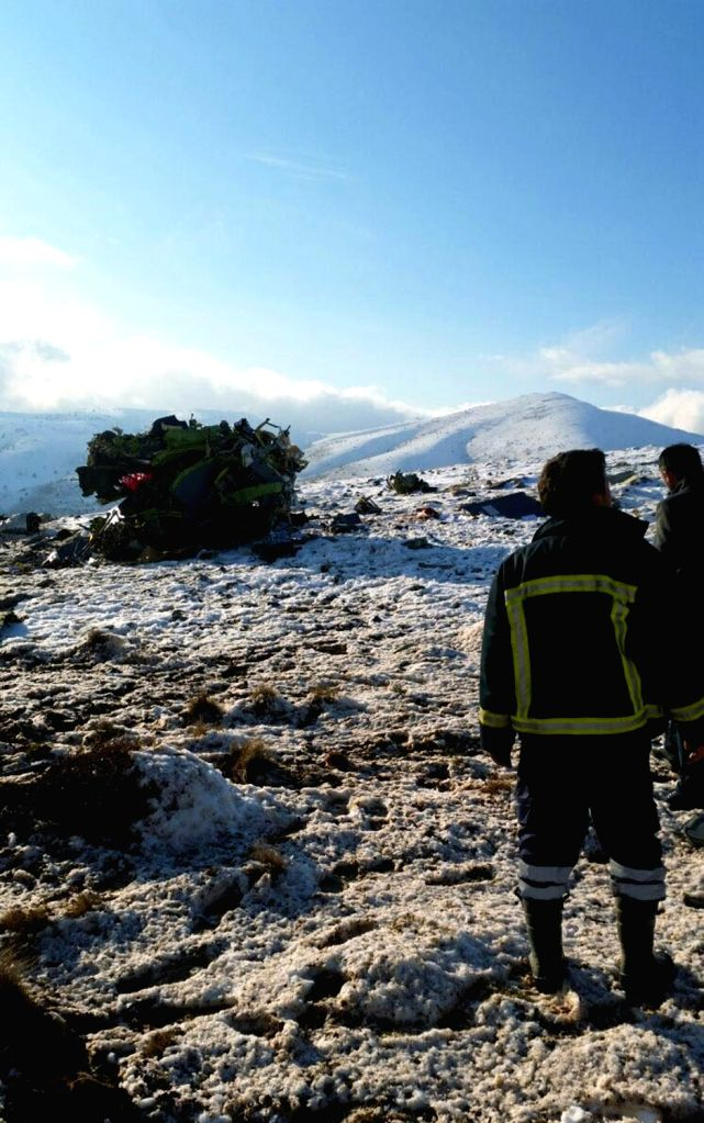 ANKARA, Jan. 17, 2018 - People gather near the debris of a Turkish military CASA-type cargo plane which crashed in the southern Anatolian province of Isparta, Turkey, on Jan. 17, 2018. The Turkish ...