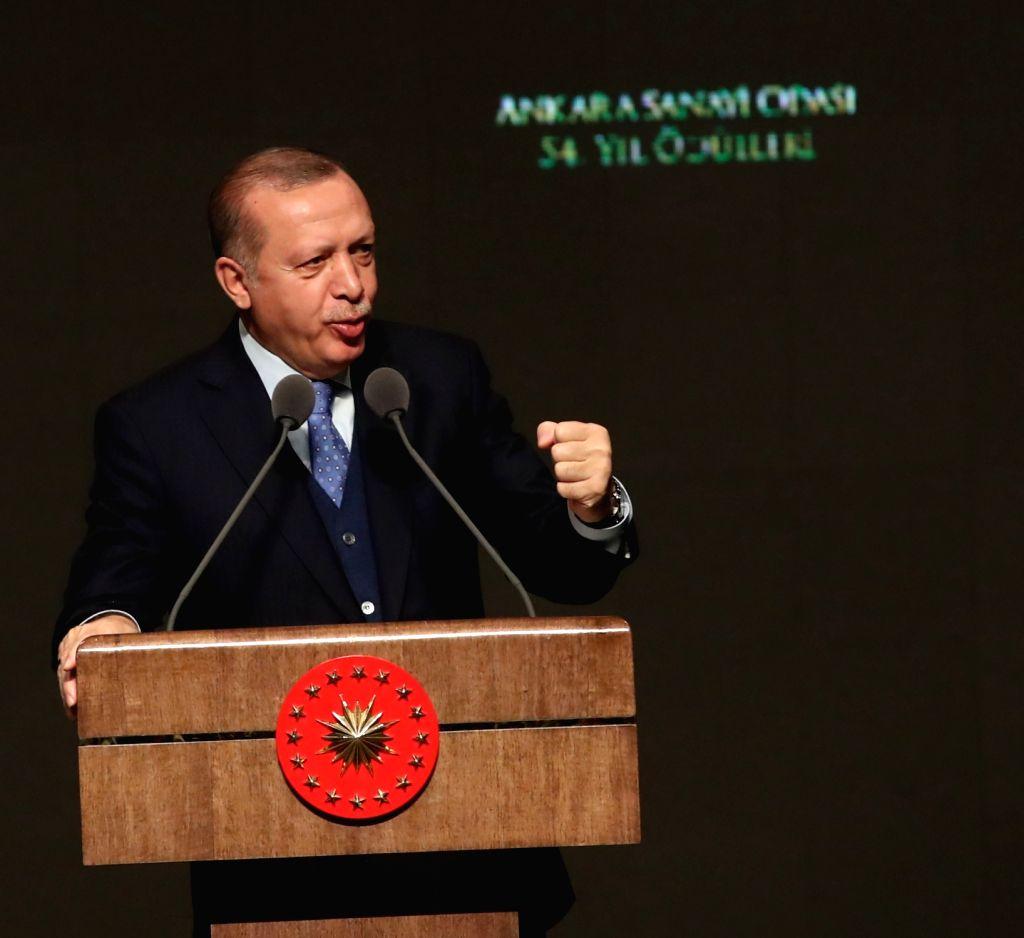 ANKARA, Jan. 22, 2018 - Turkish President Recep Tayyip Erdogan speaks during an award ceremony in Ankara, Turkey, Jan. 22, 2017. Turkey will not take a step back from its operation against the ...