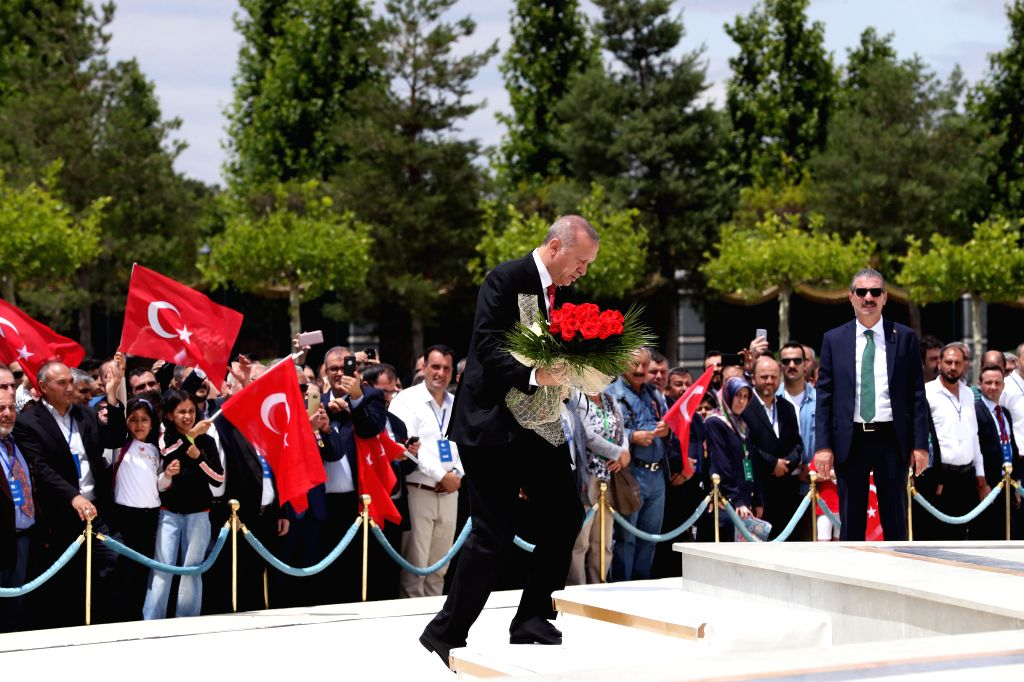 ANKARA, July 15, 2019 - Turkish President Recep Tayyip Erdogan (front) lays flowers at the July 15 Martyrs' Monument in Ankara, Turkey, on July 15, 2019. Turkey on Monday held nationwide ceremonies ...
