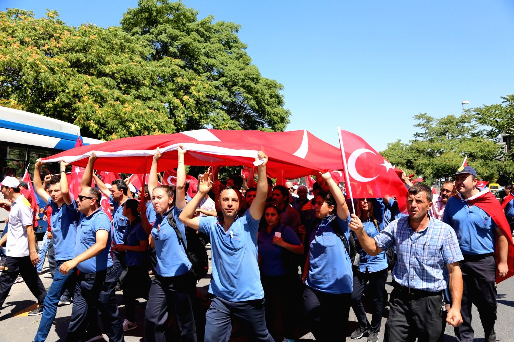 ANKARA, July 16, 2016 - People protest against the coup outside the parliament building in Ankara, Turkey, July 16, 2016. Turkey's prime minister said on Saturday that at least 161 people were killed ...
