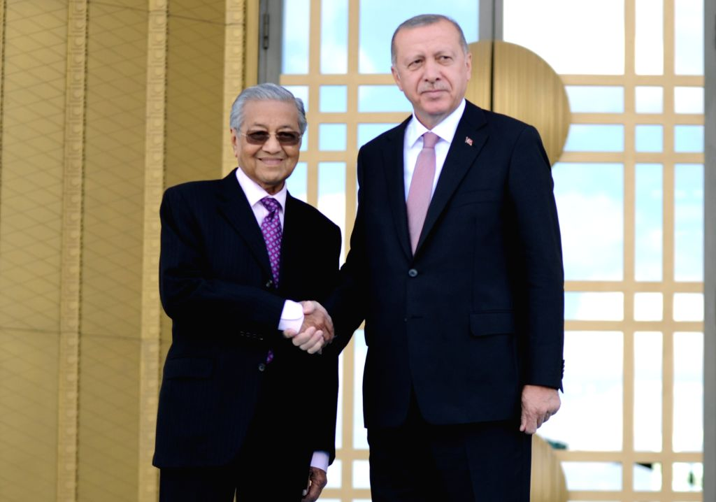 ANKARA, July 25, 2019 - Turkish President Recep Tayyip Erdogan (R) shakes hands with visiting Malaysian Prime Minister Mahathir Mohamad during a welcoming ceremony at the Presidential Palace in ... - Mahathir Mohamad