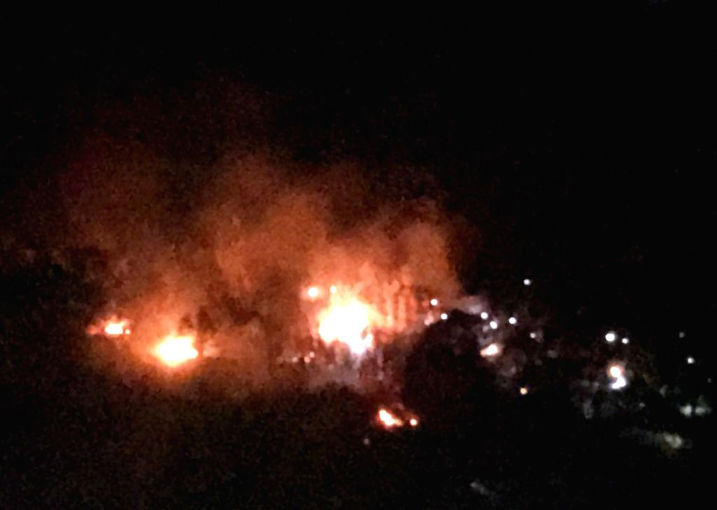 ANKARA, June 1, 2017 - This cellphone photo taken on May 31, 2017 shows the scene of a military helicopter crash in Sirnak, Turkey. A total of 13 military personnel were killed in the military ...