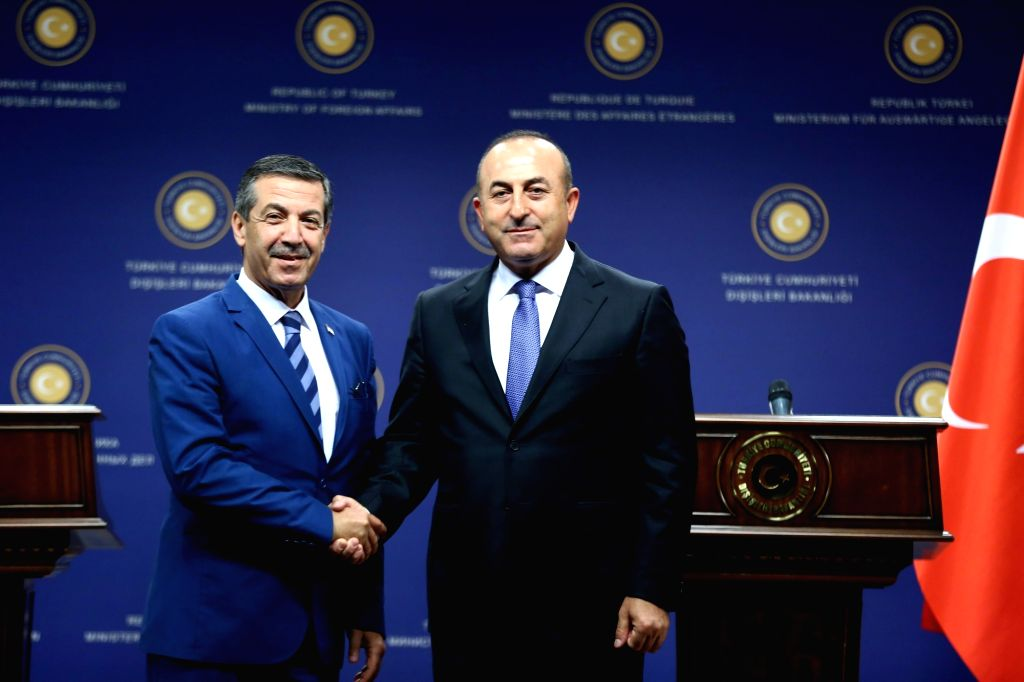 ANKARA, June 22, 2016 - Turkish Foreign Minister Mevlut Cavusoglu (R) attends a joint press conference with his Turkish Cypriot Administration counterpart Tahsin Ertugruloglu in Ankara, Turkey on ... - Mevlut Cavusoglu