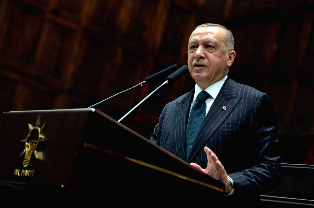 """ANKARA, June 25, 2019 (Xinhua) -- Turkish President Recep Tayyip Erdogan addresses lawmakers of the ruling Justice and Development Party (AKP) in Ankara, Turkey, on June 25, 2019. Recep Tayyip Erdogan on Tuesday vowed to learn lessons from """"the messa"""
