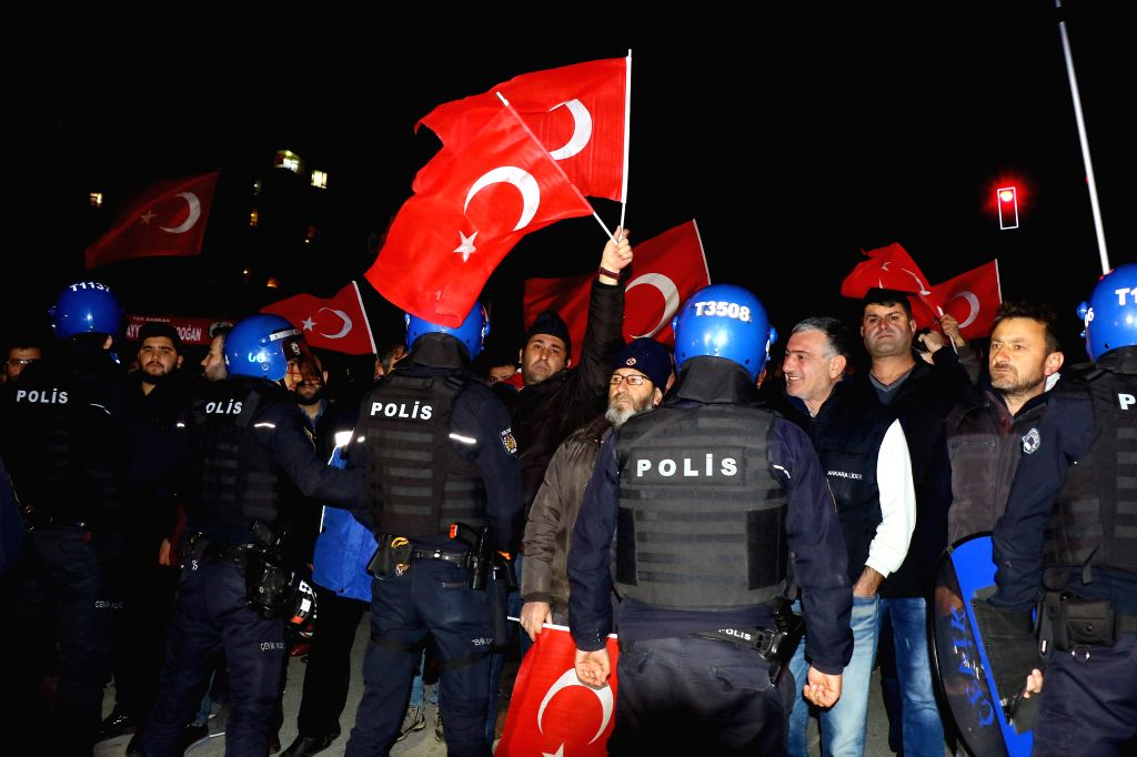ANKARA, March 12, 2017 - People attend a protest outside the Dutch Embassy in Ankara, Turkey, March 12, 2017. People holding Turkish national flags were gathering in front of Dutch Embassy in Ankara ...