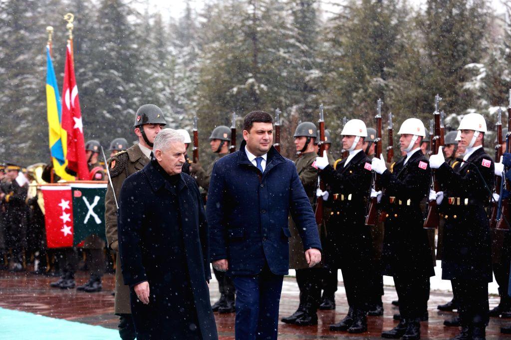 ANKARA, March 15, 2017 - Turkish Prime Minister Binali Yildirim (L F) accompanies his Ukrainian counterpart Volodymyr Groysman (C) in reviewing the guard of honor in Ankara March 14, 2017. - Binali Yildirim