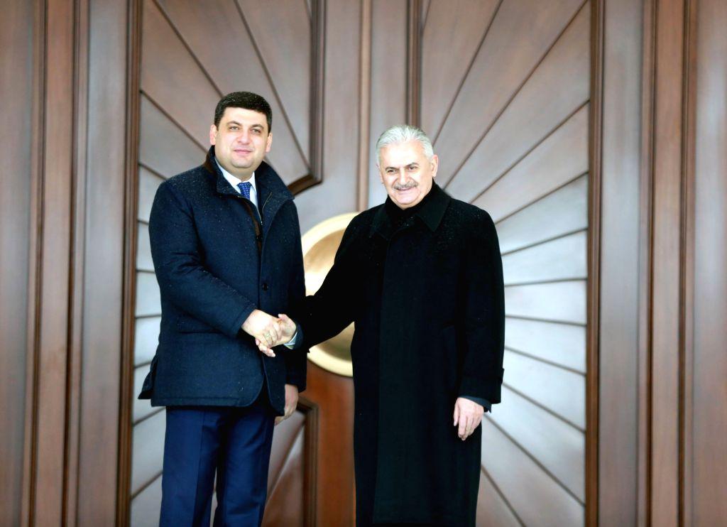 ANKARA, March 15, 2017 - Turkish Prime Minister Binali Yildirim (R) meets with his Ukrainian counterpart Volodymyr Groysman in Ankara March 14, 2017. - Binali Yildirim