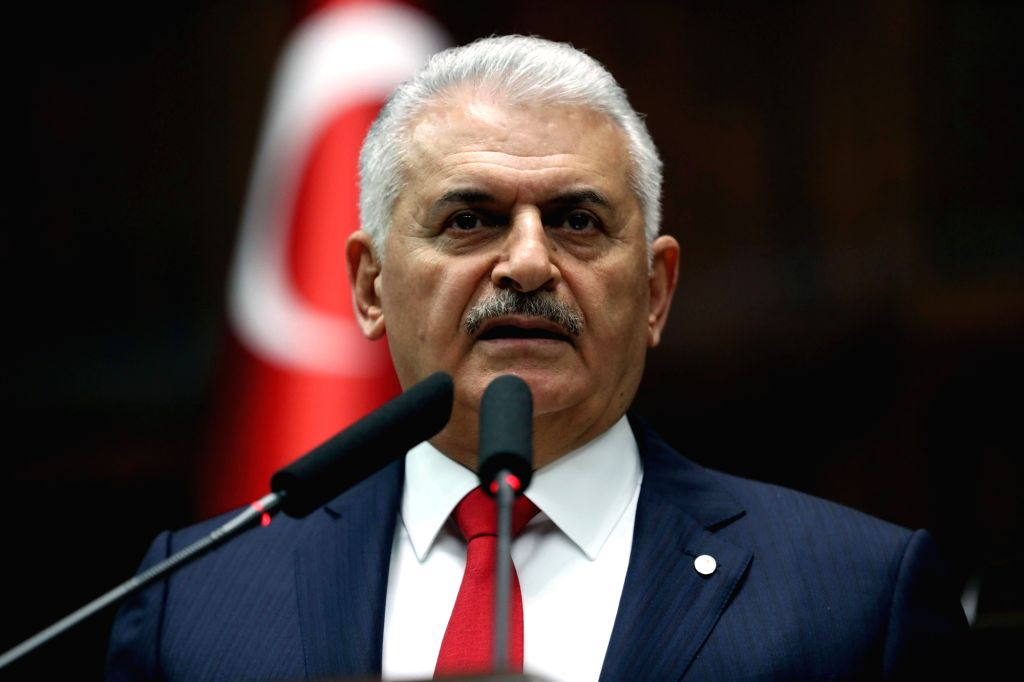 ANKARA, March 27, 2018 (Xinhua) -- Turkish Prime Minister Binali Yildirim addresses the ruling Justice and Development Party's lawmakers at parliament in Ankara, Turkey, March 27, 2018. Turkey assured Iraq that it would not carry out any cross-border - Binali Yildirim