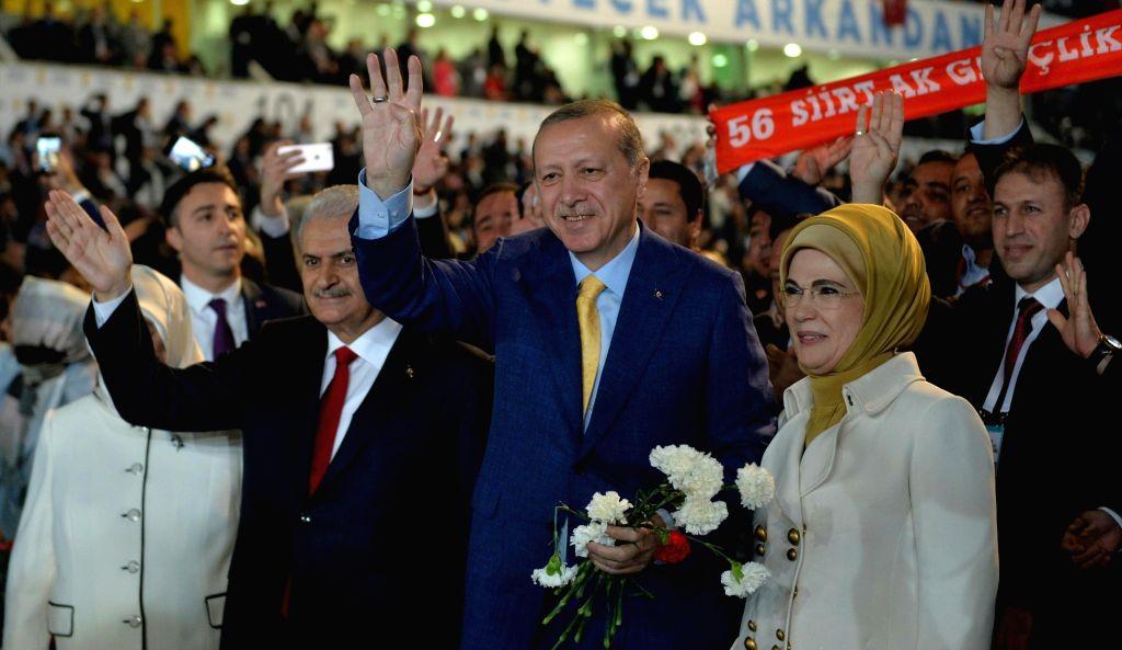 ANKARA, May 21, 2017 - Turkish President Tayyip Erdogan(C), accompanied by his wife Emine Erdogan and Prime Minister Binali Yildirim, greet members of his party during the Extraordinary Congress of ... - Binali Yildirim
