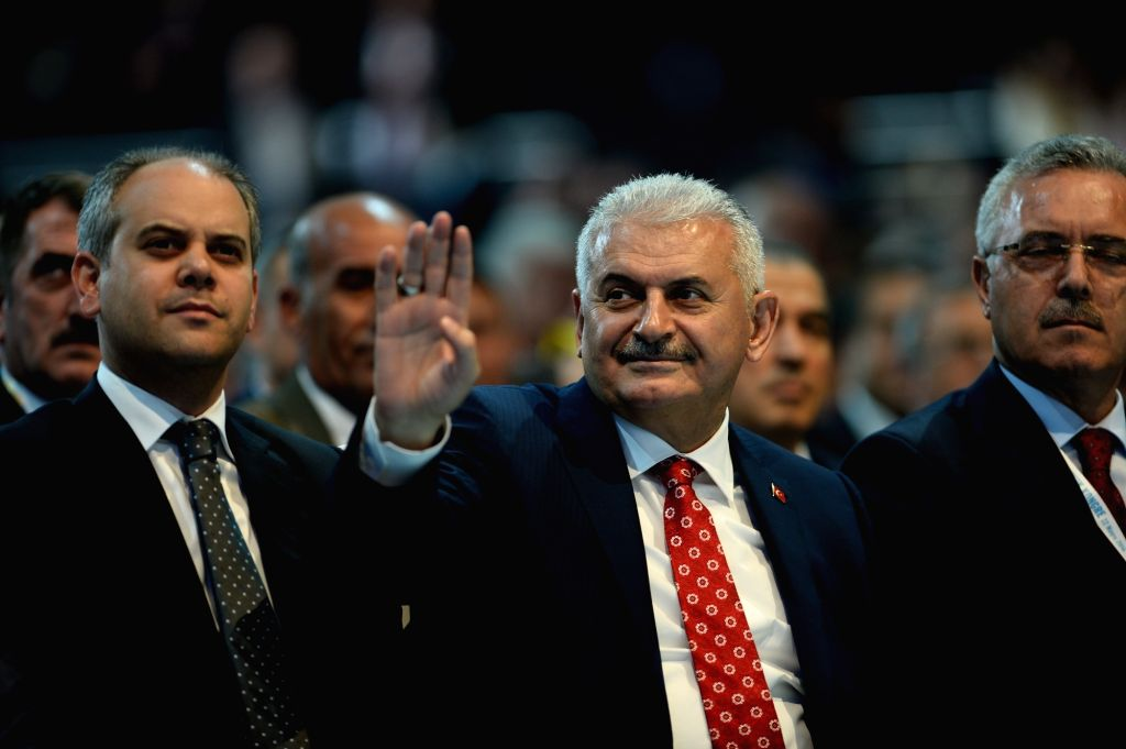 ANKARA, May 22, 2016 - Binali Yildirim(C) waves to his supporters at the congress of Turkish ruling Justice and Development Party in Ankara, Turkey on May 22, 2016. The ruling AK Party held an ...