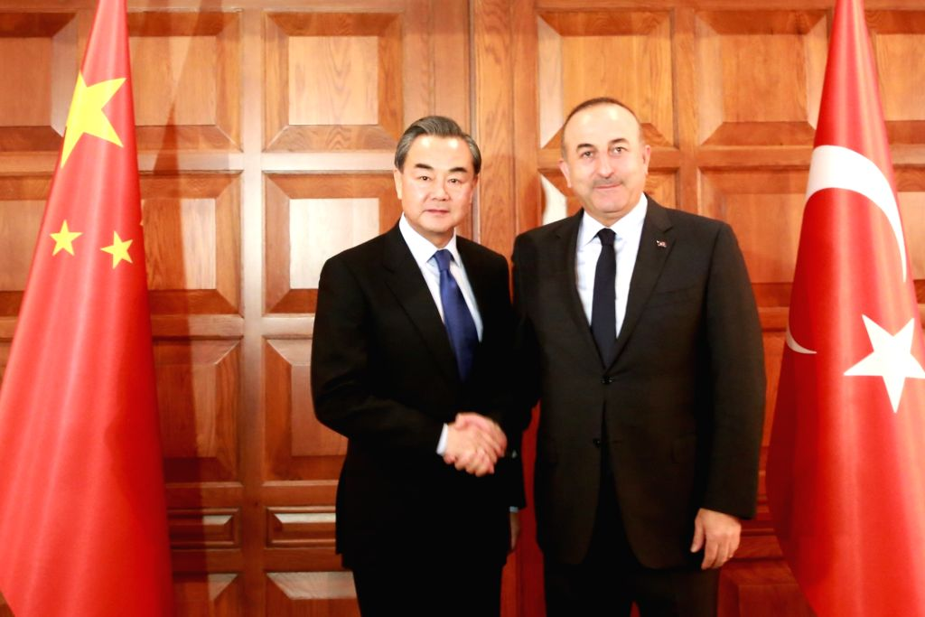 ANKARA, Nov. 13, 2016 - Chinese Foreign Minister Wang Yi (L) and his Turkish counterpart Mevlut Cavusoglu meet with journalists after the first meeting of the foreign ministers' consultation ... - Wang Y