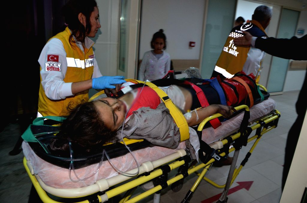 ANKARA, Nov. 30, 2016 - An injured student is transfered to hospital from a high school dormitory building fire site in Aladag district of Adana province in southeastern Turkey, Nov. 29, 2016. Eleven ...