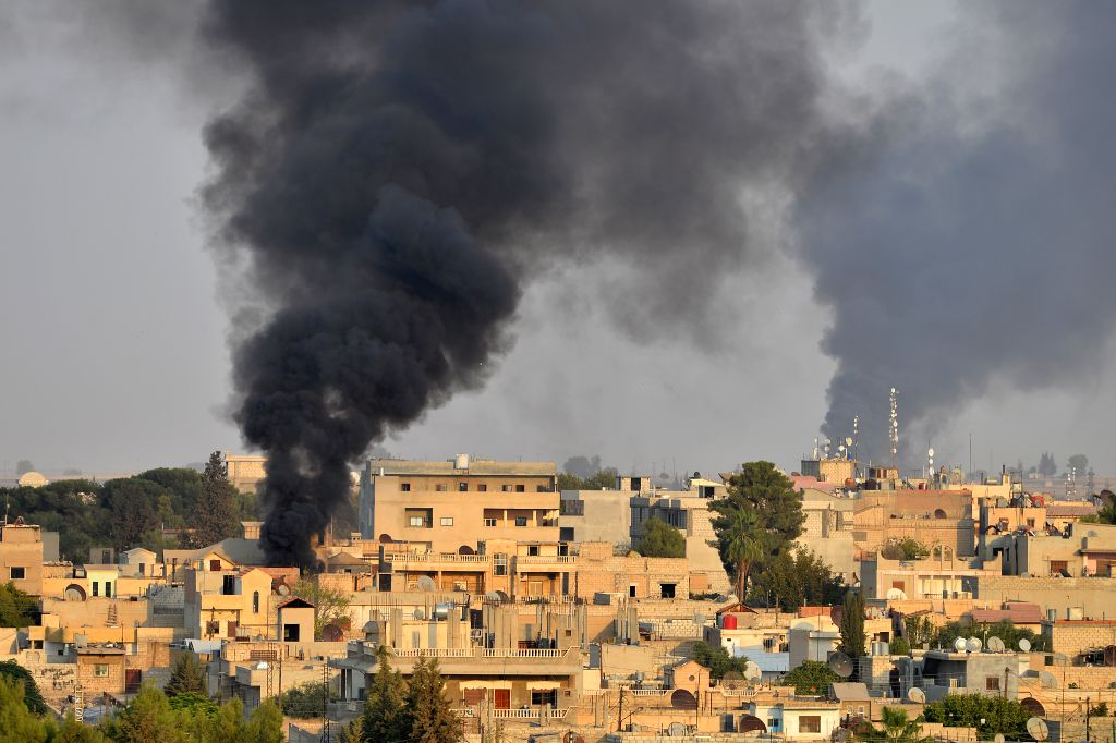 ANKARA, Oct. 10, 2019 - Photo taken on Oct. 9, 2019 shows the northern Syrian city of Ras al-Ain which is under Turkish military attack, as seen from the southern Turkish border town of Ceylanpinar. ...