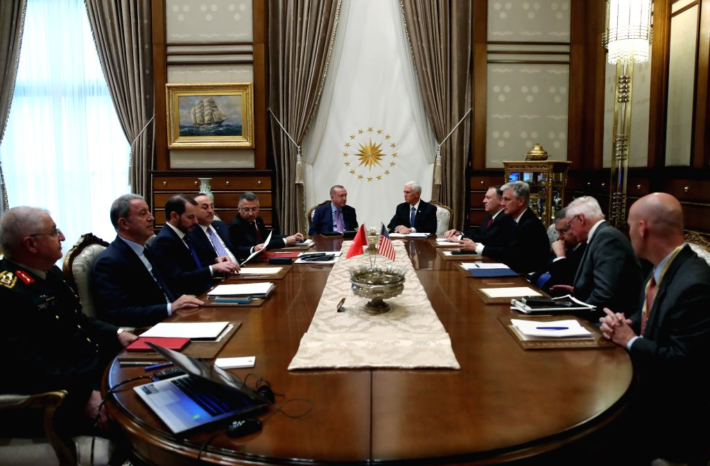 ANKARA, Oct. 17, 2019 - Turkish President Recep Tayyip Erdogan (L, center) meets with U.S. Vice President Mike Pence (R, center) in Ankara, Turkey, on Oct. 17, 2019. The United States and Turkey on ...