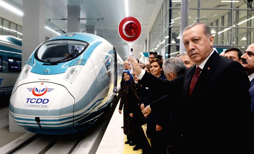 ANKARA, Oct. 30, 2016 - Turkish President Recep Tayyip Erdogan (Front) attends the opening ceremony of the new high speed train station in Ankara, Turkey, Oct. 29, 2016. A new high speed train ... - Binali Yildirim