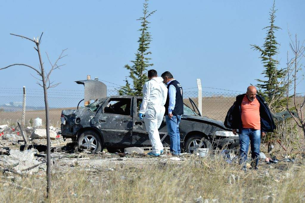ANKARA, Oct. 8, 2016 - Police check the car in which two suicide bombers blew themselves up during anti-terror operations in Turkish capital Ankara on Oct. 8, 2016. The terrorists were reportedly ...