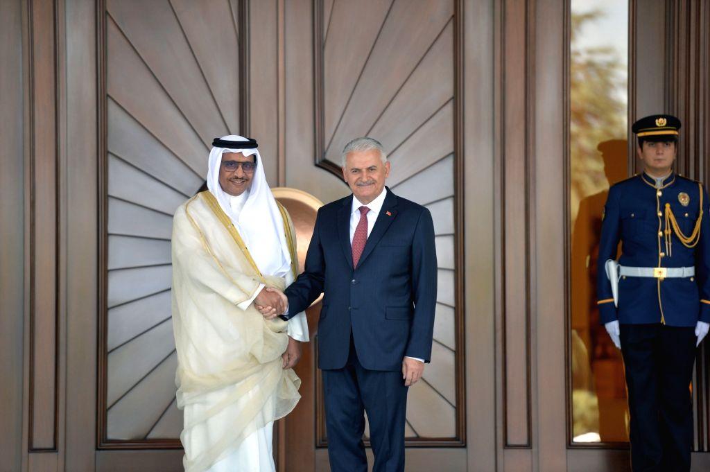 ANKARA, Sept. 14, 2017 - Turkish Prime Minister Binali Yildirim (2nd L) shakes hands with visiting Kuwaiti Prime Minister Sheikh Jaber Al-Mubarak Al-Hamad Al-Sabah (1st L) during an official welcome ... - Binali Yildirim and Jaber A