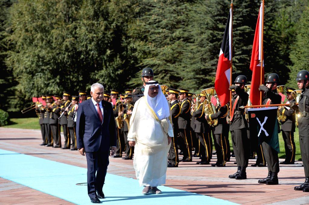ANKARA, Sept. 14, 2017 - Turkish Prime Minister Binali Yildirim (1st L, Front) and visiting Kuwaiti Prime Minister Sheikh Jaber Al-Mubarak Al-Hamad Al-Sabah (2nd L, Front) inspect the honor guard ... - Binali Yildirim and Jaber A