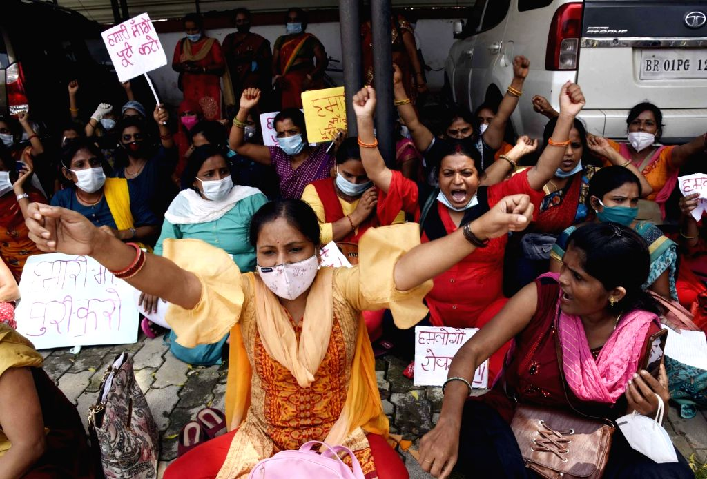 ANM workers protest surrounding Health Minister Mangal Pandey, in Patna on August 30, 2020. - Mangal Pandey