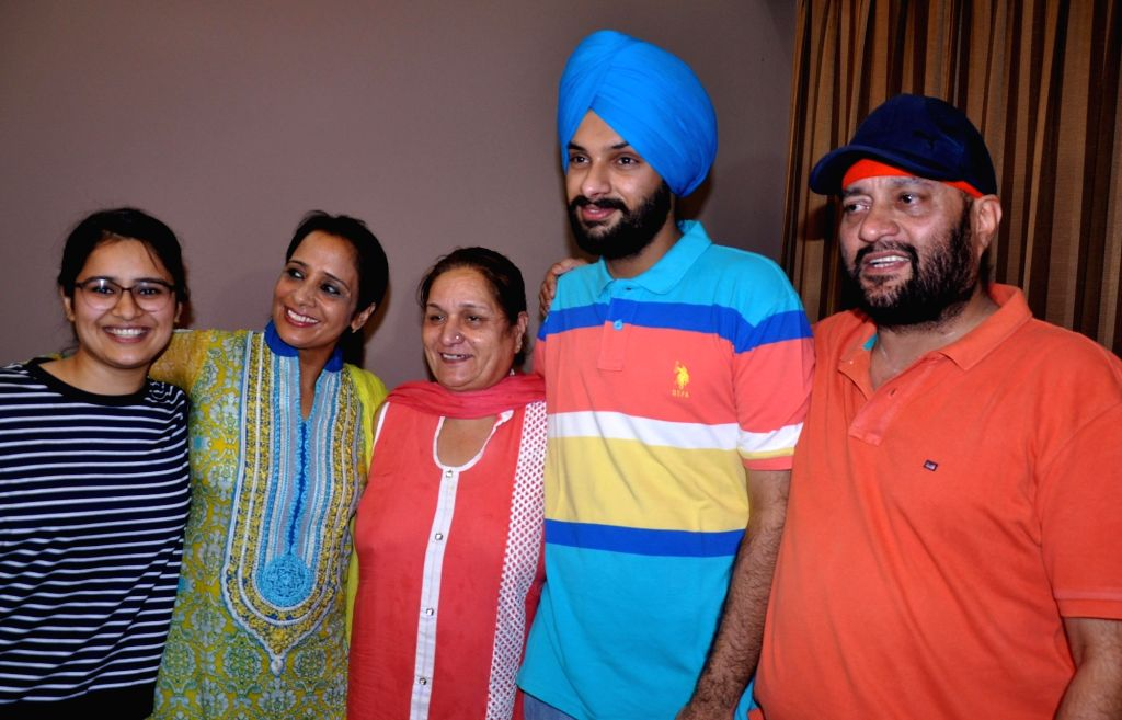 Anmol Sher Singh Bedi who stood 2nd rank in UPSC examination, celebrates with family members in Amritsar on May 31, 2017.