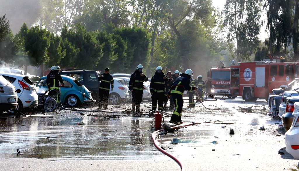 ANTALYA, Oct. 25, 2016 - Firemen work at the explosion site in Antalya, Turkey, Oct. 25, 2016. A huge explosion occurred in the the parking lot of the Antalya Chamber of Commerce building on Tuesday ...