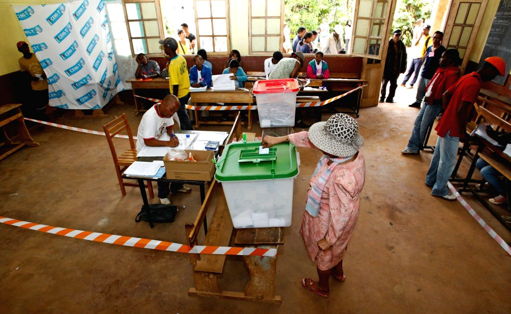 A woman casts her vote at a polling station in Antananarivo, capital of Madagascar, on Dec. 20, 2013. Voters in Madagascar went to the polls on Friday to .