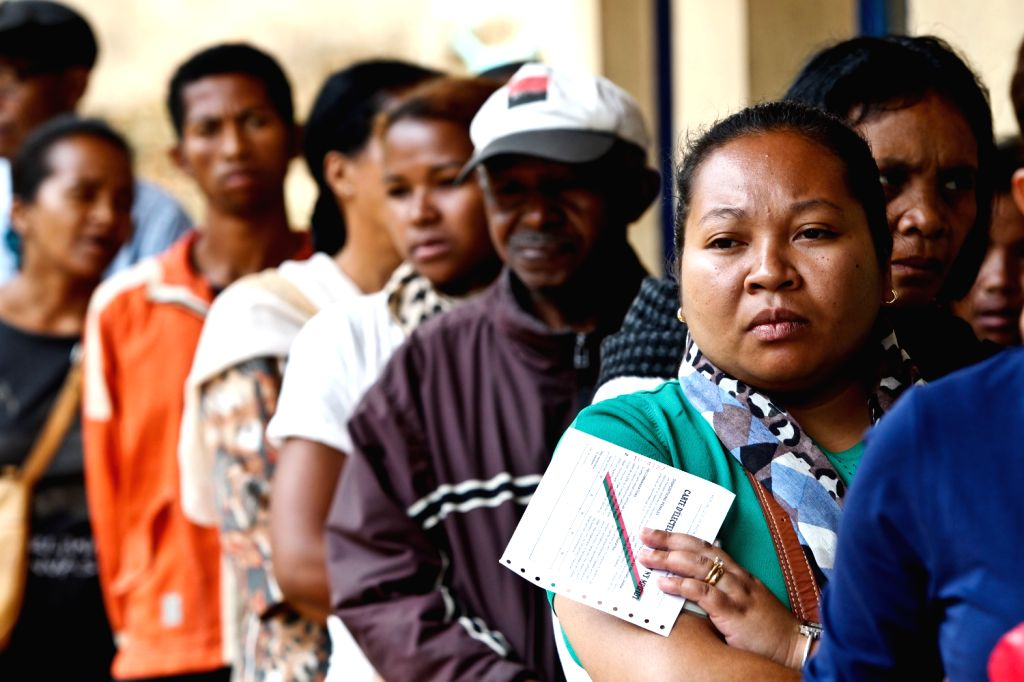 People wait to cast their votes at a polling station in Antananarivo, capital of Madagascar, on Dec. 20, 2013. Voters in Madagascar went to the polls on ..