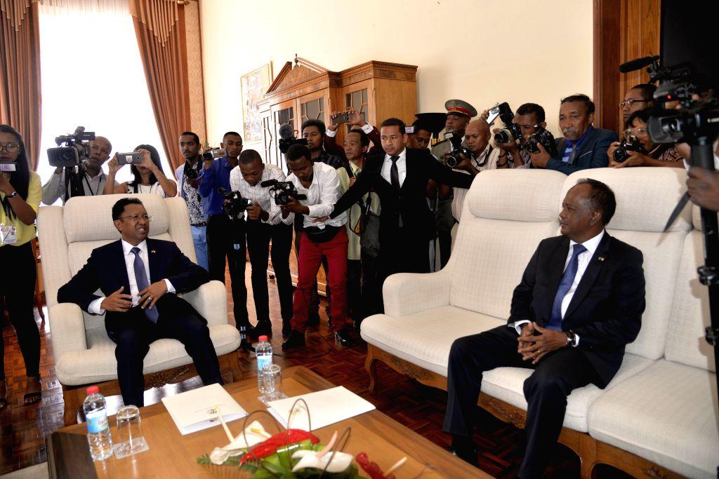 ANTANANARIVO, Jan. 18, 2019 - Hery Rajaonarimampianina (L front) talks with acting president Rivo Rakotovao (R front) in the Presidential Palace in Antananarivo, capital of Madagascar on Jan. 18, ...