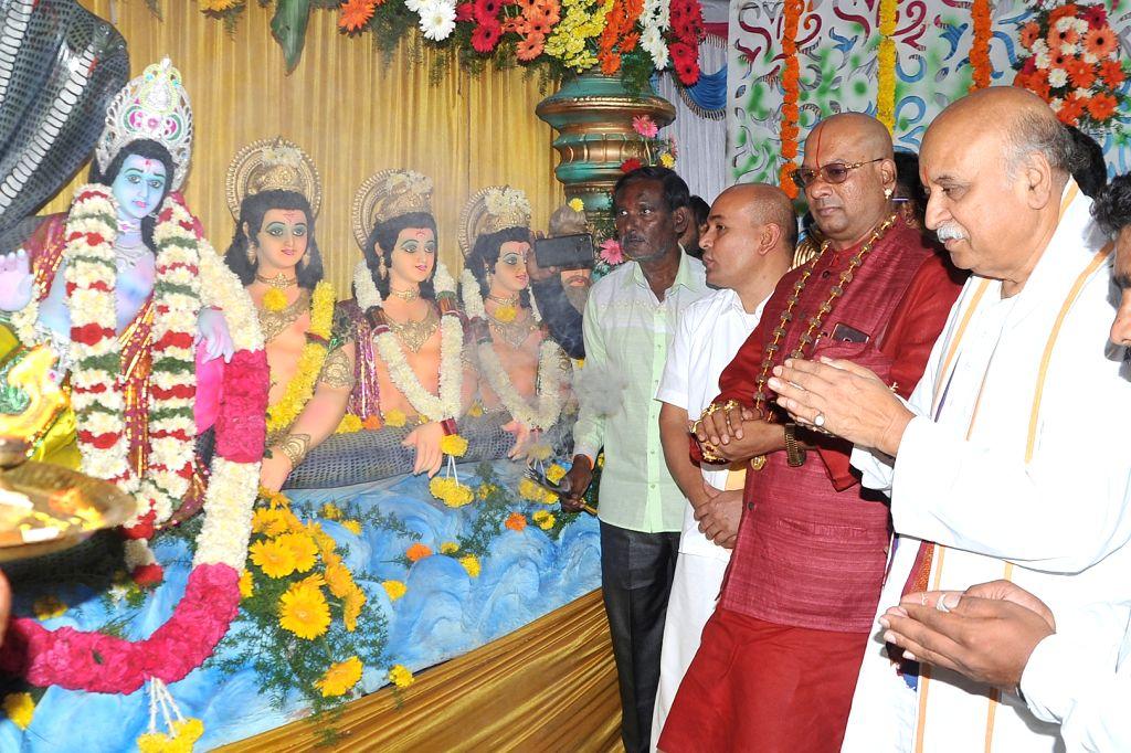Antarrashtriya Hindu Parishad President Praveen Togadia offers prayers during the 2nd anniversary celebrations of 'Maha Ganpati Utsav' organised by Rashtriya Bajrang Dal, in Bengaluru on ...
