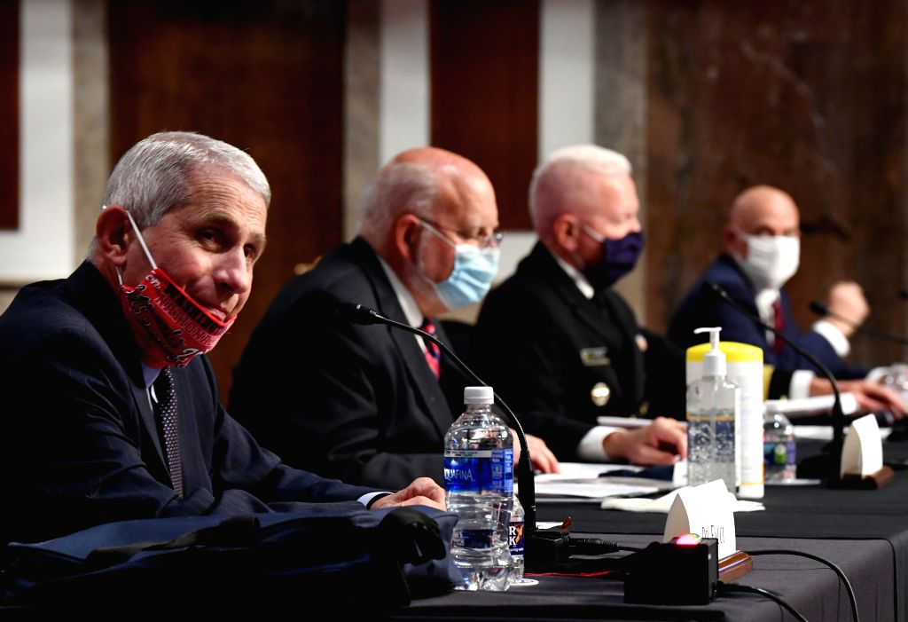 Anthony Fauci (1st L), director of the National Institute of Allergy and Infectious Diseases, testifies before the U.S. Senate Committee on Health, Education, ...