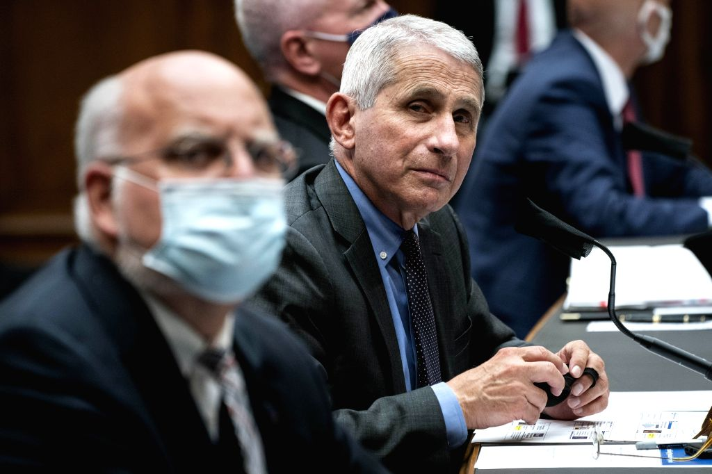 Anthony Fauci, director of the U.S. National Institute of Allergy and Infectious Diseases, prepares to testify before the House Energy and Commerce Committee on ...