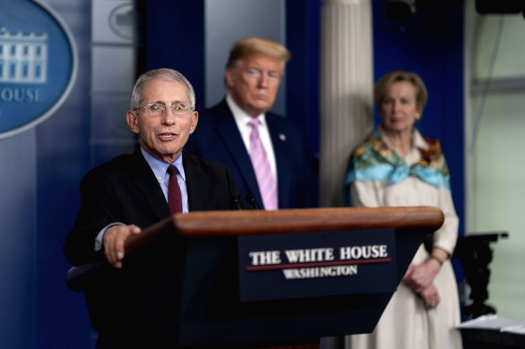 Anthony Fauci, from left, the medical adviser to United States President Donald Trump on COVID-19, Deborah Birx, the coordinator of the White House Coronavirus Task Force, at a news conference on April 4, 2020, in Washington. (Photo: White House/IANS