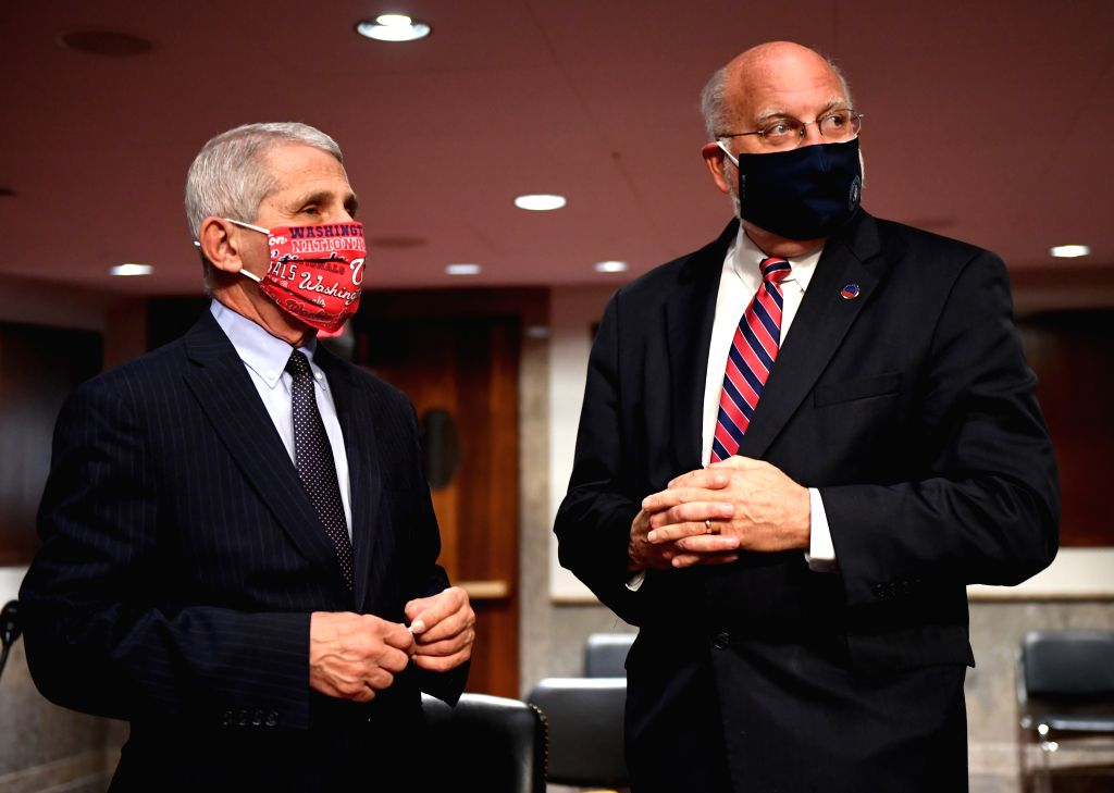 Anthony Fauci (L) , director of the National Institute of Allergy and Infectious Diseases, and Robert Redfield, director of the U.S. Centers for Disease Control ...