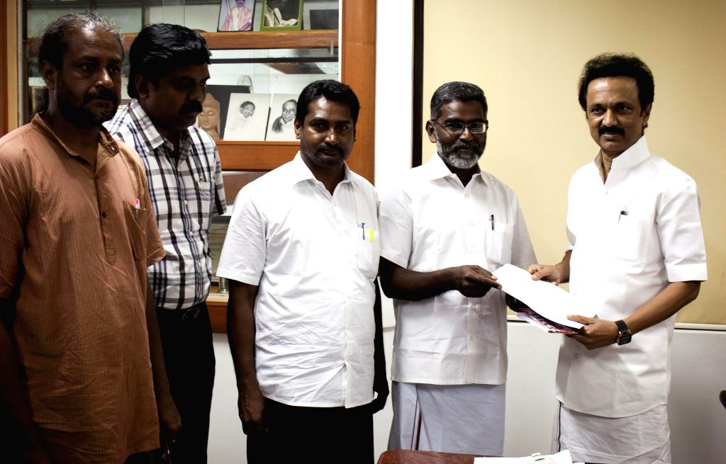 Anti-nuclear activist SP Udayakumar meets DMK leader M K Stalin at DMK headquarters in Chennai on July 30, 2014.