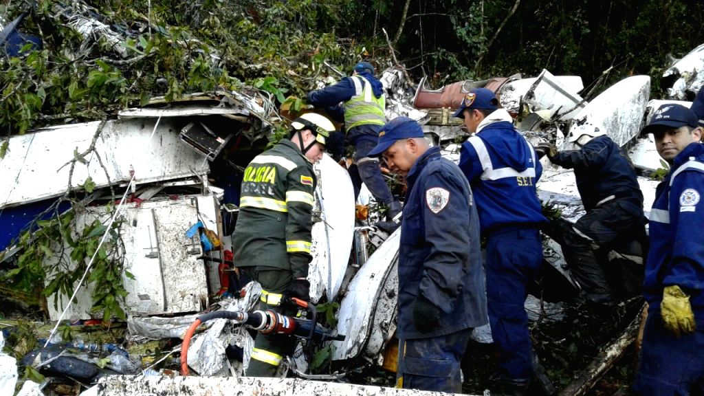 ANTIOQUIA (COLOMBIA), Nov. 29, 2016 Photo provided by Noticias Telemedellin shows security members inspecting the site of a crashed plane carrying the Brazilian soccer team Chapecoense, ...