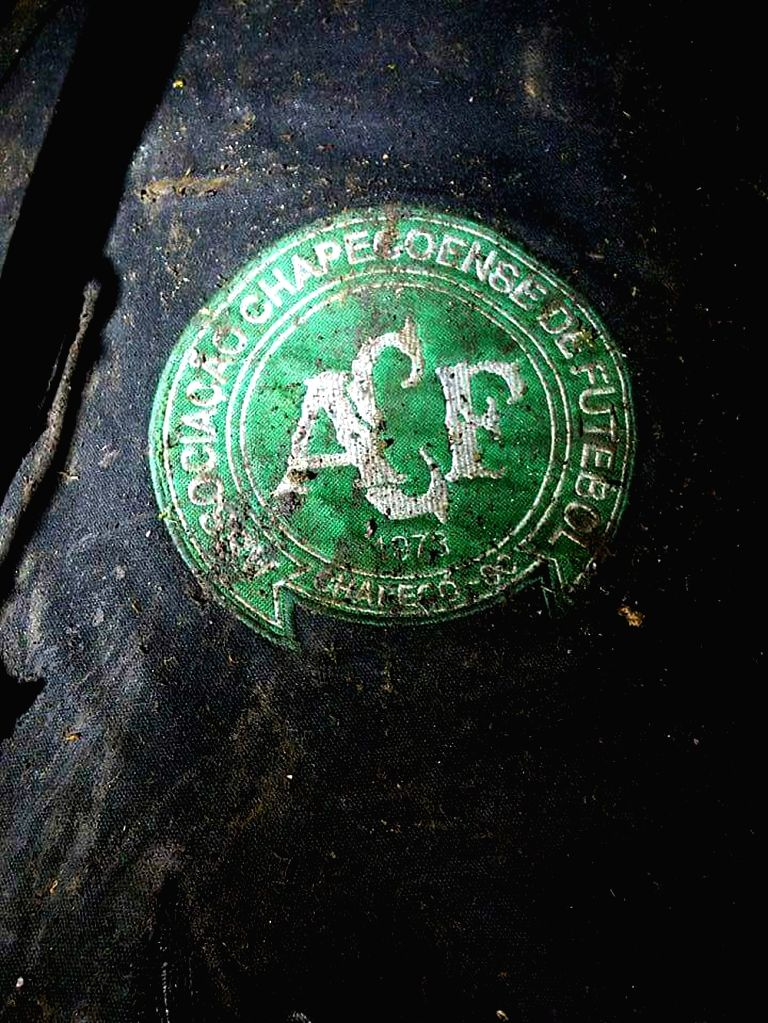ANTIOQUIA, Nov. 29, 2016 - Photo taken on Nov. 28, 2016 provided by Noticias Telemedellin, shows a logo of Brazilian football team Chapecoense at the site of the plane crashed in a mountainous area ...
