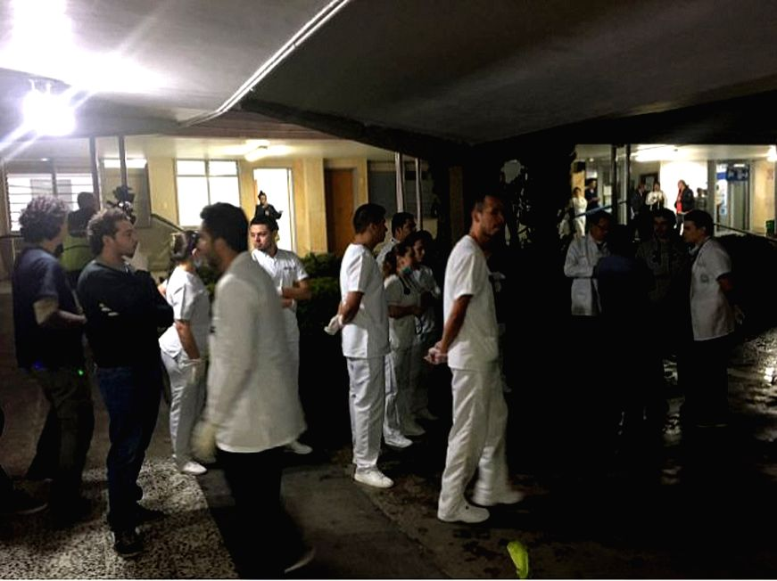 ANTIOQUIA, Nov. 29, 2016 - Photo taken on Nov. 29, 2016 provided by Noticias Telemedellin shows medical staffs waiting for survivors of the crashed plane carrying the Brazilian football team ...