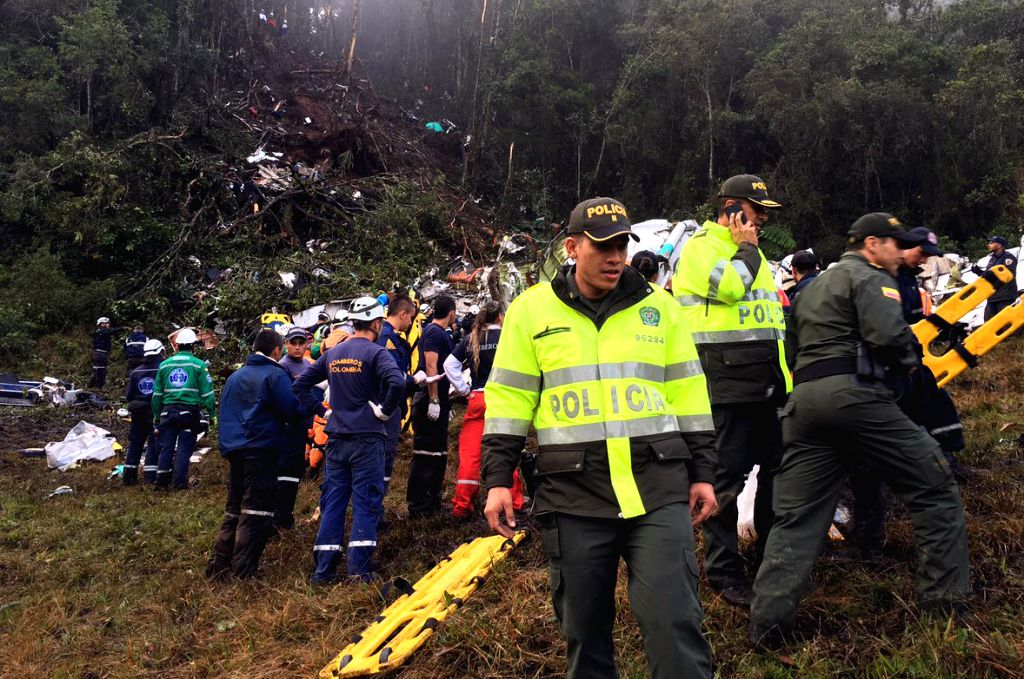 ANTIOQUIA, Nov. 30, 2016 - Security members inspect the site of the crashed plane carrying Brazilian soccer team Chapecoense near Medellin, in the department of Antioquia, Colombia. The head of the ...