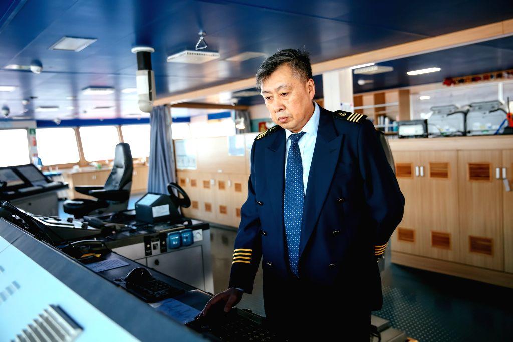 ANTWERP, Feb. 6, 2019 - Gu Mingzhang, captain of COSCO SHIPPING LIBRA, checks equipment aboard the ship at the Port of Antwerp in Belgium, Feb. 5, 2019. China's 20,000 plus twenty-foot equivalent ...