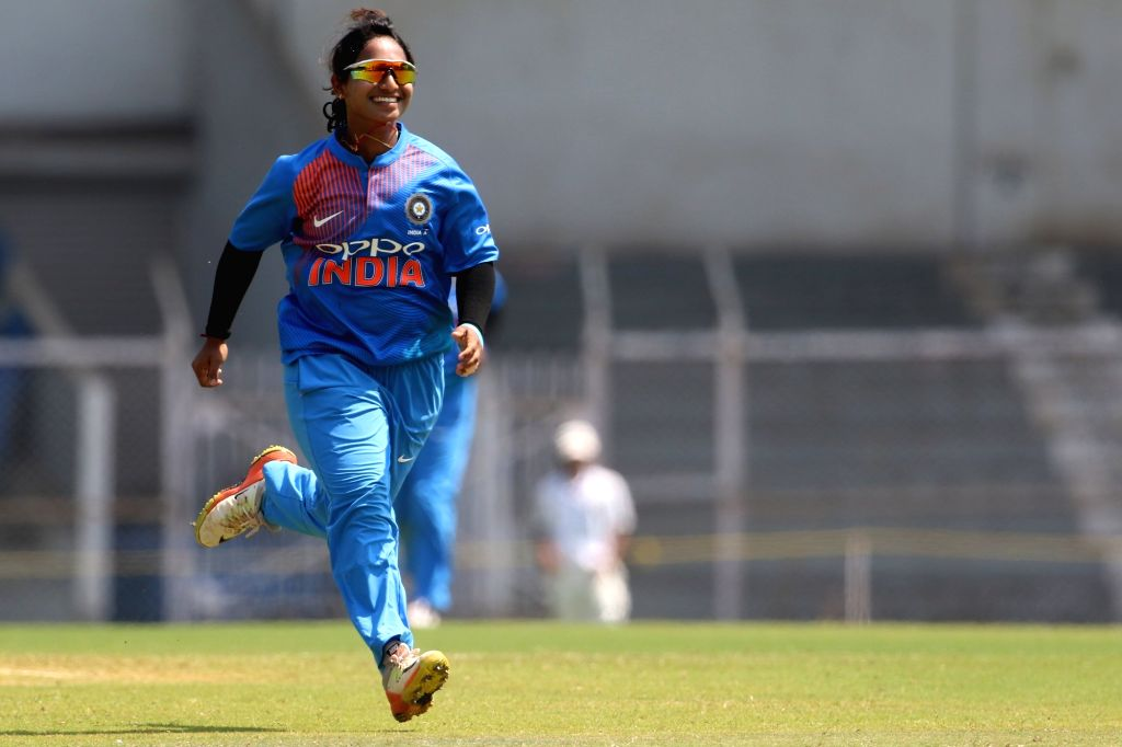 Anuja Patil of India celebrates fall of Danielle Hazell's wicket during the women's tri-series T20I match between India and England at the Brabourne Stadium in Mumbai on March 29, 2018. - Anuja Patil