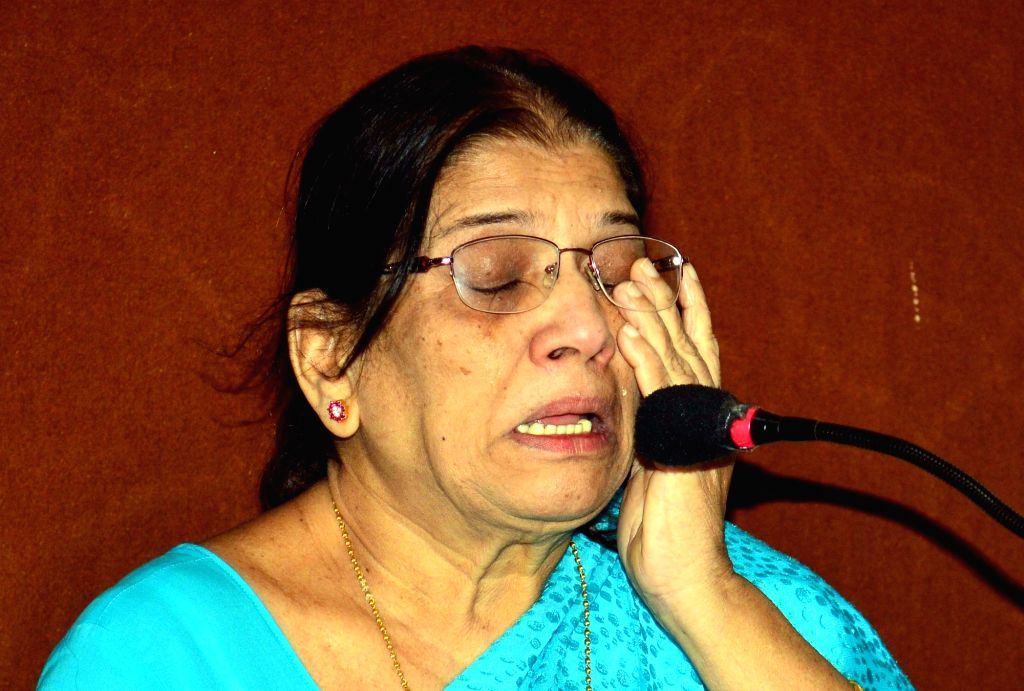 Anuradha Ashok Paldhe, mother of Amar Ashok Paldhe an Indian Navy sailor who died 23 years ago at sea under mysterious circumstances breaks down during a press conference in Mumbai on June ...